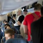 110312-f-nw653-129_passengers_board_a_delta_air_lines_aircraft-590x332.jpg