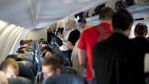 110312-f-nw653-129_passengers_board_a_delta_air_lines_aircraft-590x332.jpg
